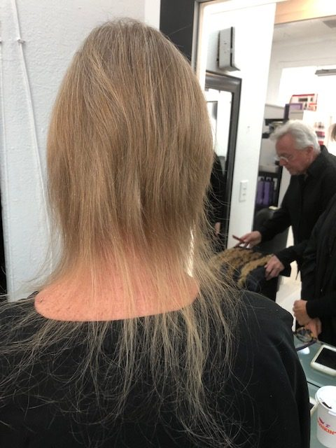 A woman with thin, blonde hair at a beauty salon.