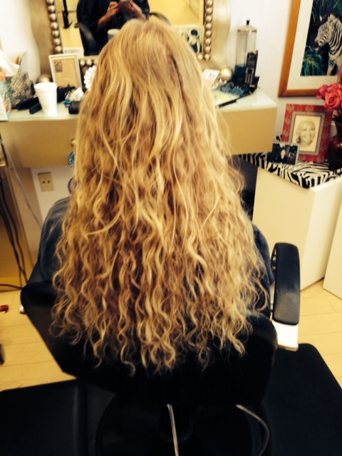 Long, blonde hair extensions by Pizzazz Beauty Salon.
