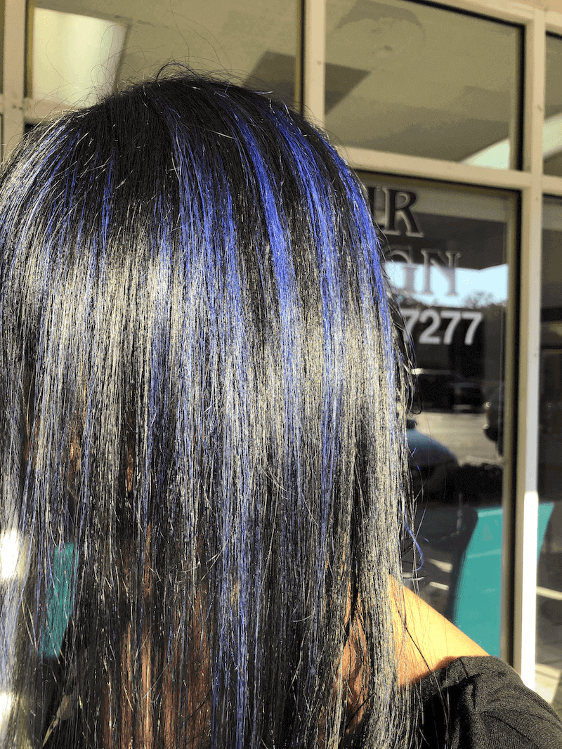 A girl with royal blue highlights on black hair.